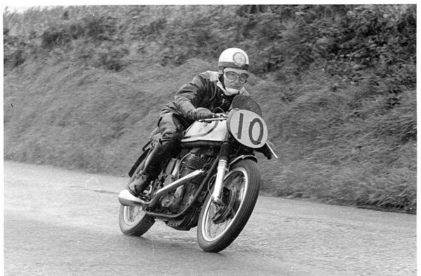 Black and white image of a vintage motorcycle racer